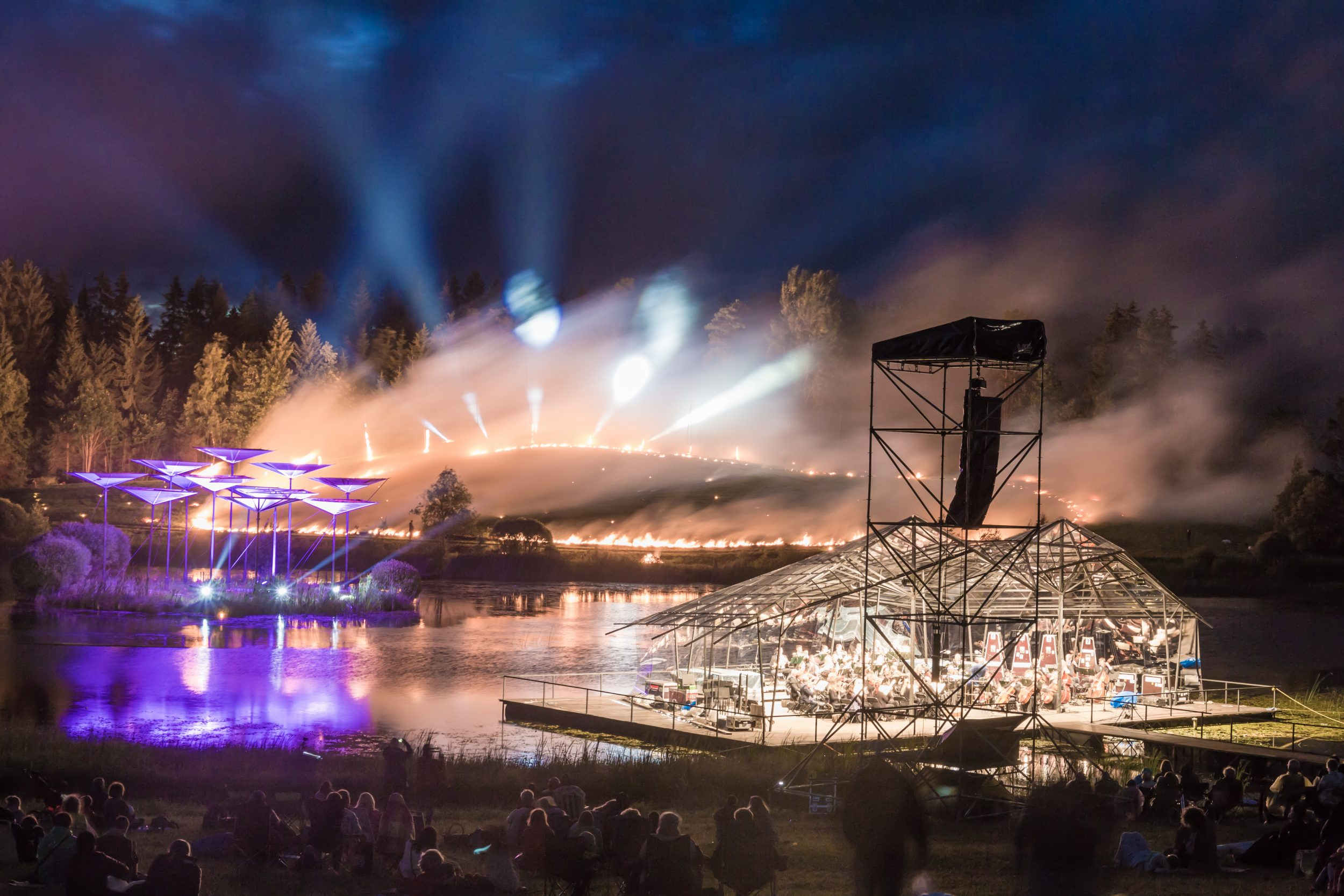 Searchlights and orchestra on water
